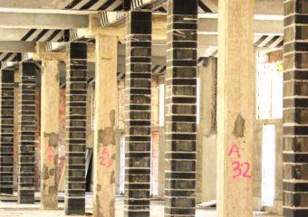 Adeguamento sismico della caserma Montezemolo in Roma: rinforzo a flessione e taglio delle travi principali mediante CARBOSTRU® T-System e a pressoflessione e taglio dei pilastri con il sistema CARBOSTRU® C-System N+M+.
