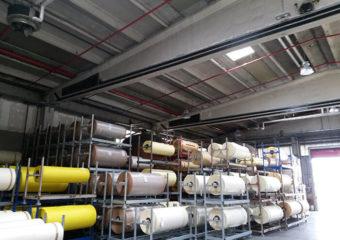 Rinforzo a flessione e taglio delle travi principali reggenti la copertura di un capannone prefabbricato mediante CARBOSTRU® T-System.