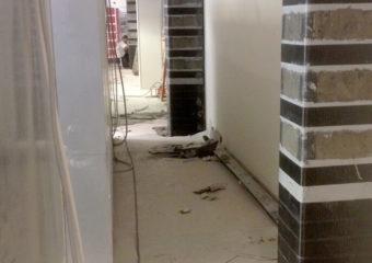 Miglioramento sismico al 60% mediante il sistema CARBOSTRU® C-System M+N+ per i pilastri al piano terra e piano primo del punto vendita COOP Reno di Poggio Renatico (FE).
